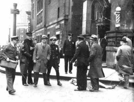 "The body of Mary Miller, surrounded by investigators. ""She waved to the crowd below... her body plummeted toward the street."". Photo courtesy of Cultural Ghosts."