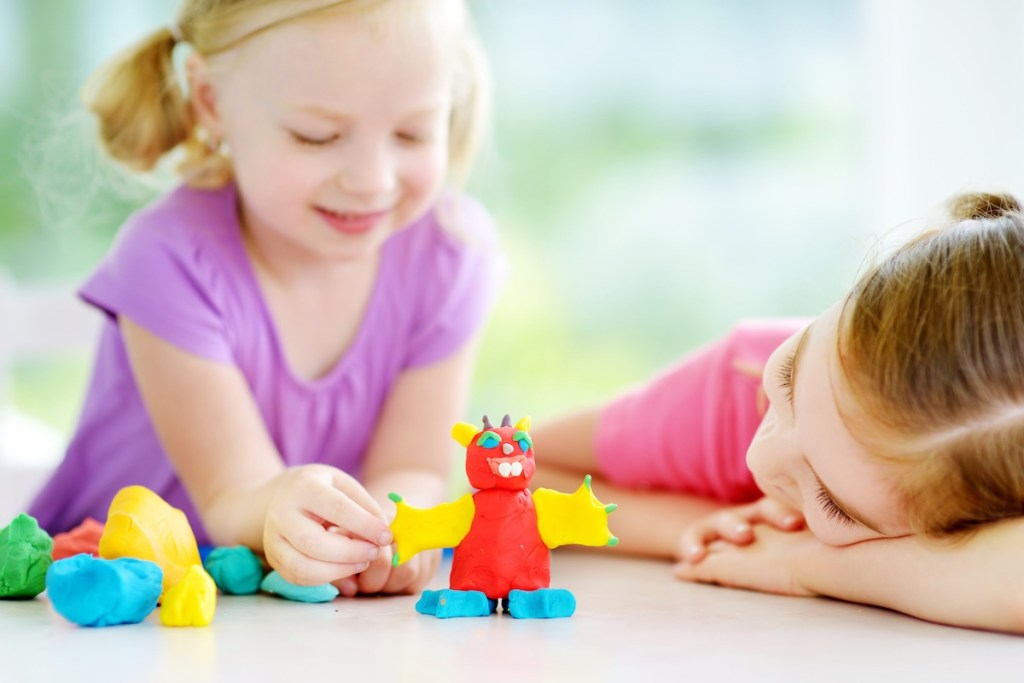 two girls playing together at daycare
