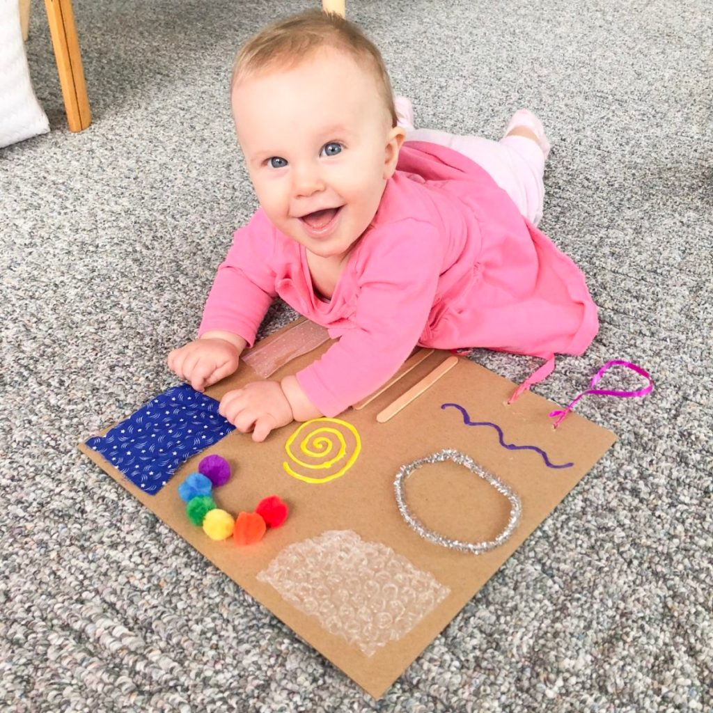 baby busy board inside playing