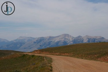 More dirt road and mountains.