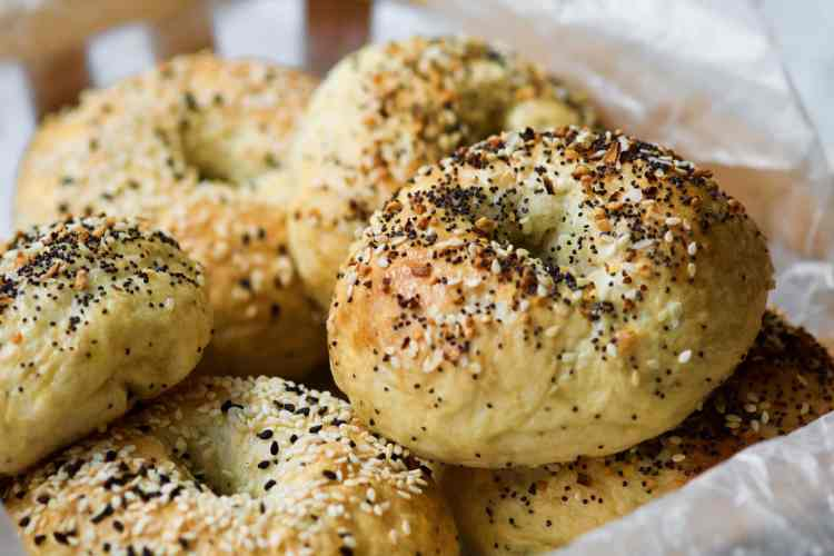 a pile of everything bagels inn a basket
