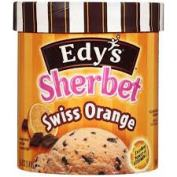 A promotional image for Edy's Swiss Orange Sherbert. A tall, round ice cream container with brown and white stripes around the lid. The container itself has dark and light orange stripes, a scoop of orange ice cream with chocolate chunks, and a photo of an orange half on it.