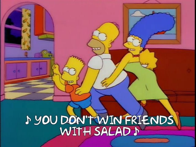 "A screenshot from the Simpsons showing the simpson family doing a line dance while singing ""you don't make friends with salad"""
