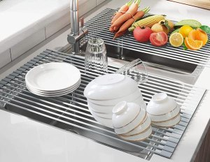 a roll up dish drying rack that lies flat across the opening of your sink