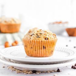 a close up of a muffin on two small dessert plates