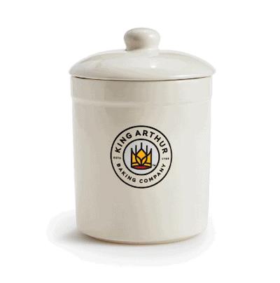 a white stoneware sourdough crock with the king arthur baking logo on the side
