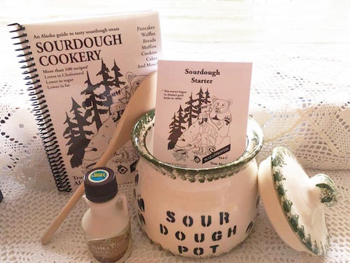 an alaskan sourdough kit with recipe book, sourdough crock, sourdough starter, and pot of birch syrup