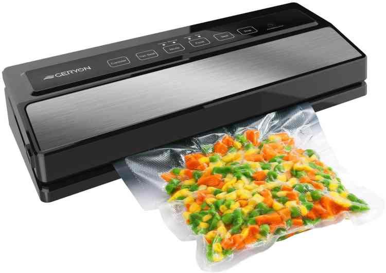 a vaccum sealer sealing a bag of frozen veggies