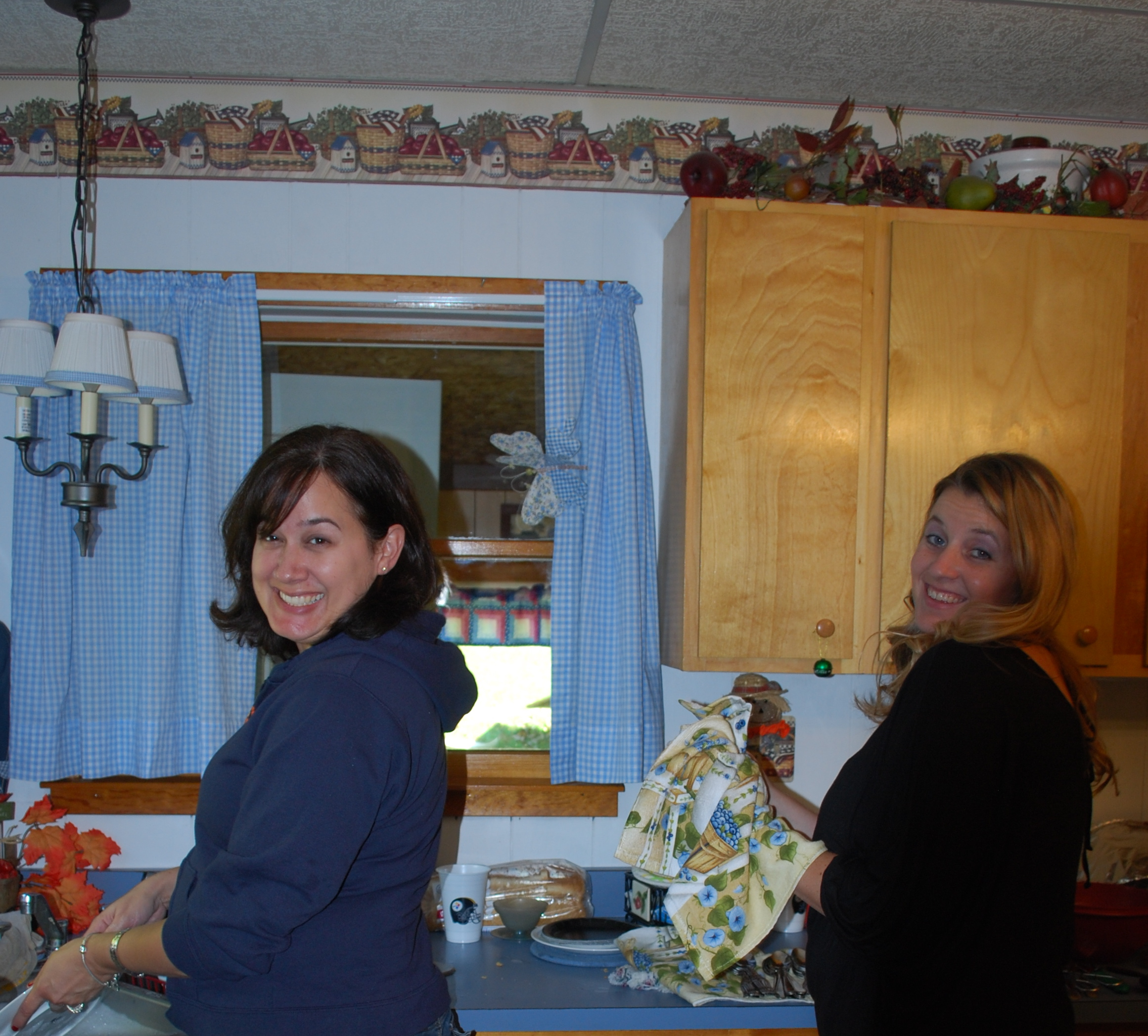 Kelli and Heather (her cousin) enjoy their vacation by doing the dishes for 18 people@