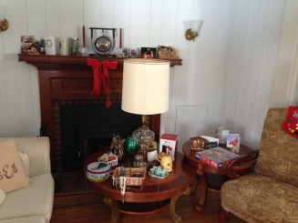 Christmas decorations and Master bedroom items cluttering our Living room.