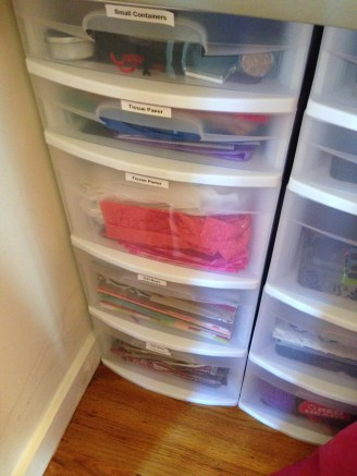 Gift wrapping supplies organization drawers on the left and craft supplies on the right