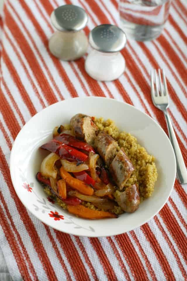 A simple and tasty dinner - chicken sausages, peppers, onions, and curry spiced quinoa.
