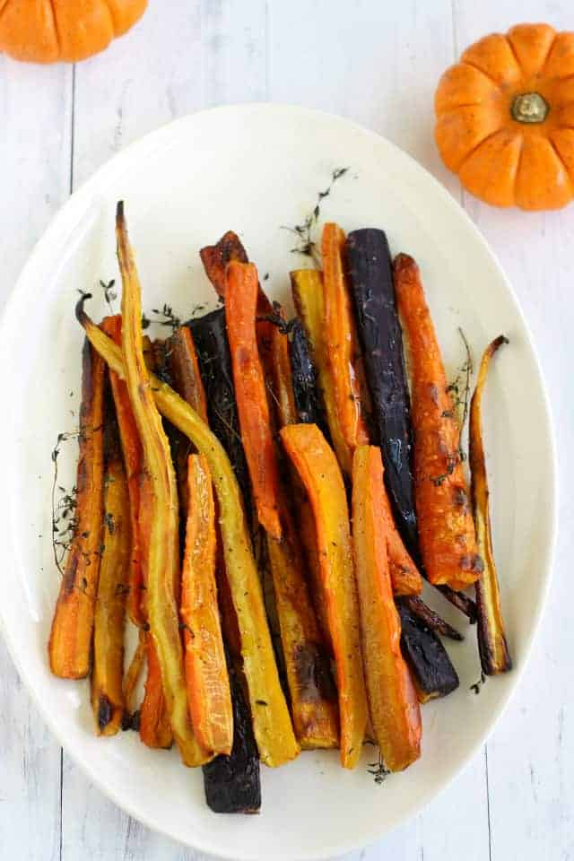 Simple and beautiful oven roasted rainbow carrots with thyme.