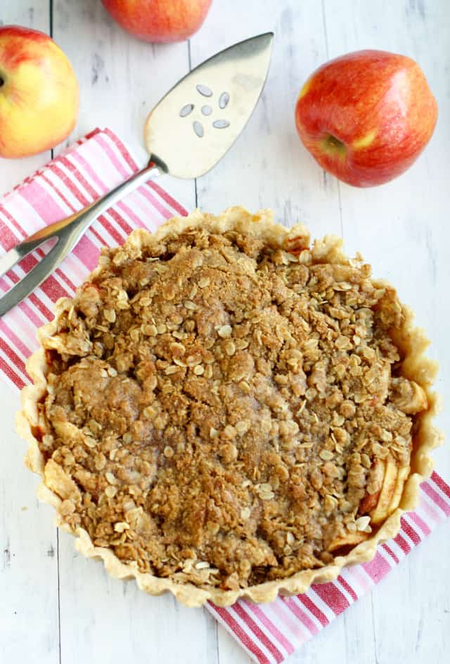 A sweet Ambrosia apple tart topped with a crunchy crumble.