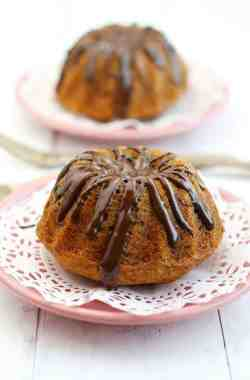 These cute banana coconut mini bundt cakes are covered with a tasty chocolate glaze! These are perfect for a special occasion! #vegan #glutenfree