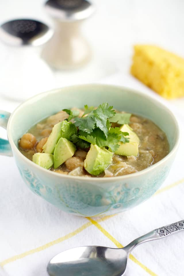 An easy and healthy white chicken chili recipe made in the crockpot. #chicken