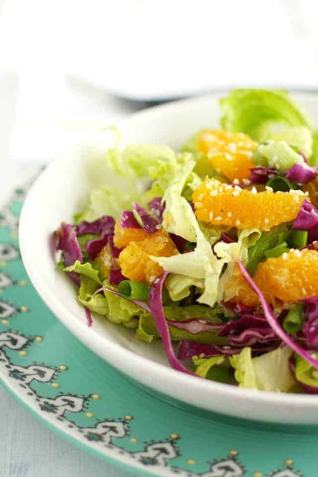 Light and refreshing crisp romaine lettuce topped with juicy oranges and a sesame dressing.