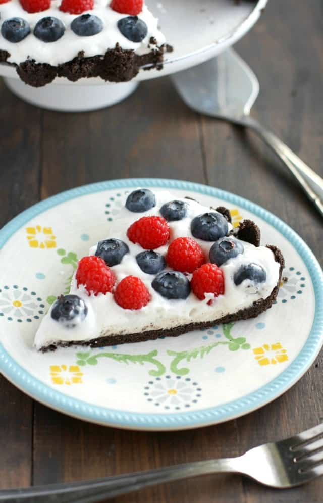The easiest patriotic tart - a no-bake dessert with a cookie crust, creamy filling, and fresh berries! #dessert #patriotic
