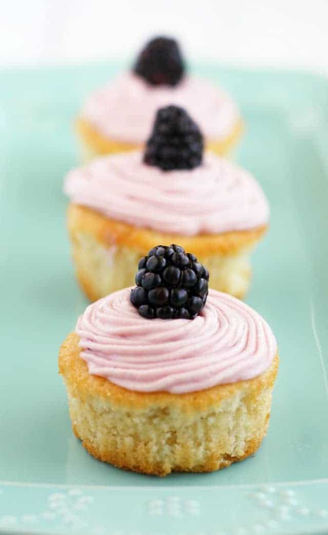Light and fluffy #vegan lemon cupcakes with sweet blackberry buttercream frosting. #cupcakes