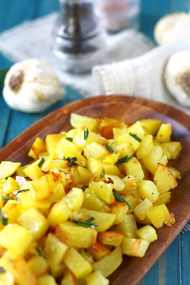 Roasted potatoes with garlic and rosemary are so delicious and very easy to make! The garlic and rosemary gives these a wonderful flavor!