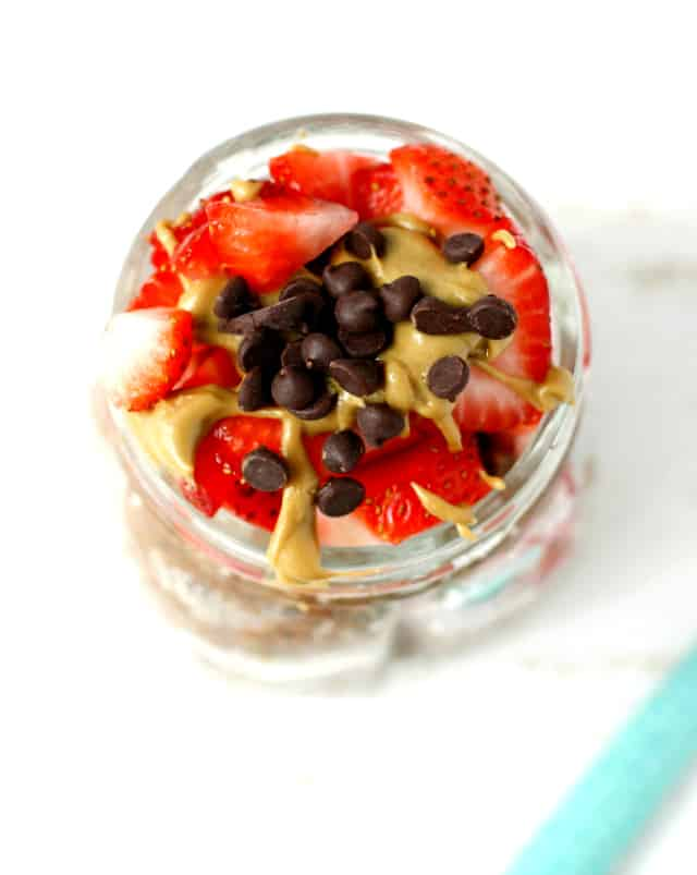Vegan chocolate chia seed pudding is a delicious breakfast treat, especially when topped with sunbutter and berries!