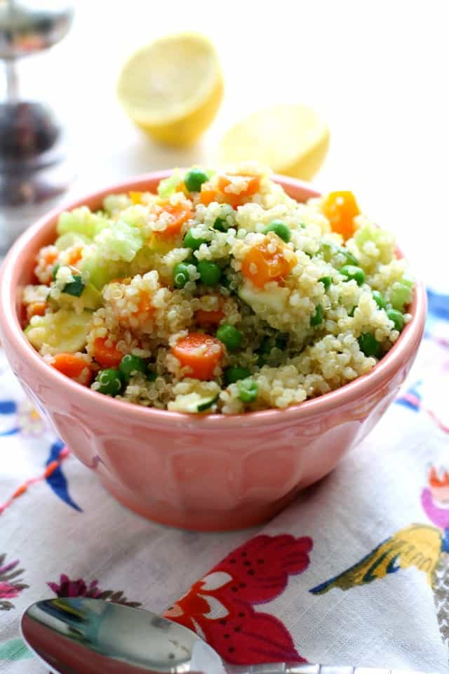 An easy vegan quinoa salad that's perfect for a picnic! It's loaded with veggies and a delicious mustard vinaigrette. Vegan and gluten free.