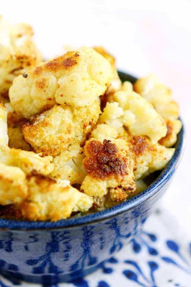 Easy, cheesy, dairy free and vegan roasted cauliflower recipe