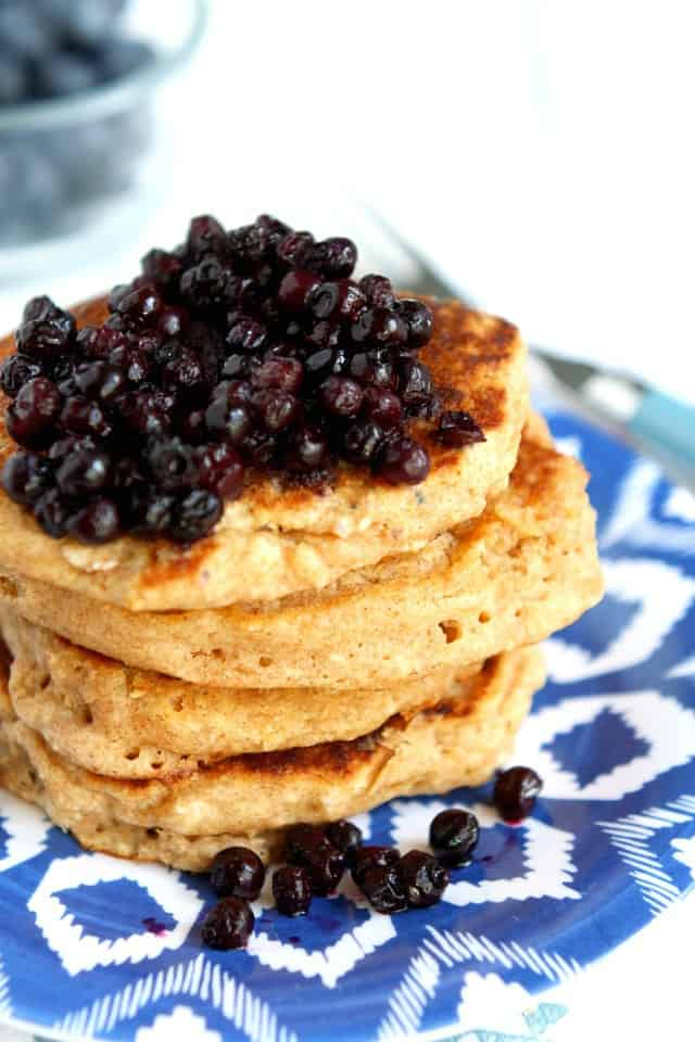 Light and fluffy dairy free multigrain pancakes are a wonderful way to start your day! Top with a warm blueberry sauce for breakfast perfection!