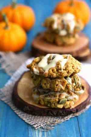 Soft and chewy gluten free and vegan pumpkin oatmeal cookies are topped with a white chocolate glaze. Delicious! #ad