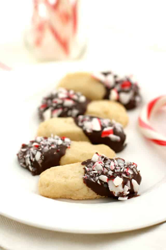 Buttery shortbread is dipped in chocolate and candy canes for a festive treat!