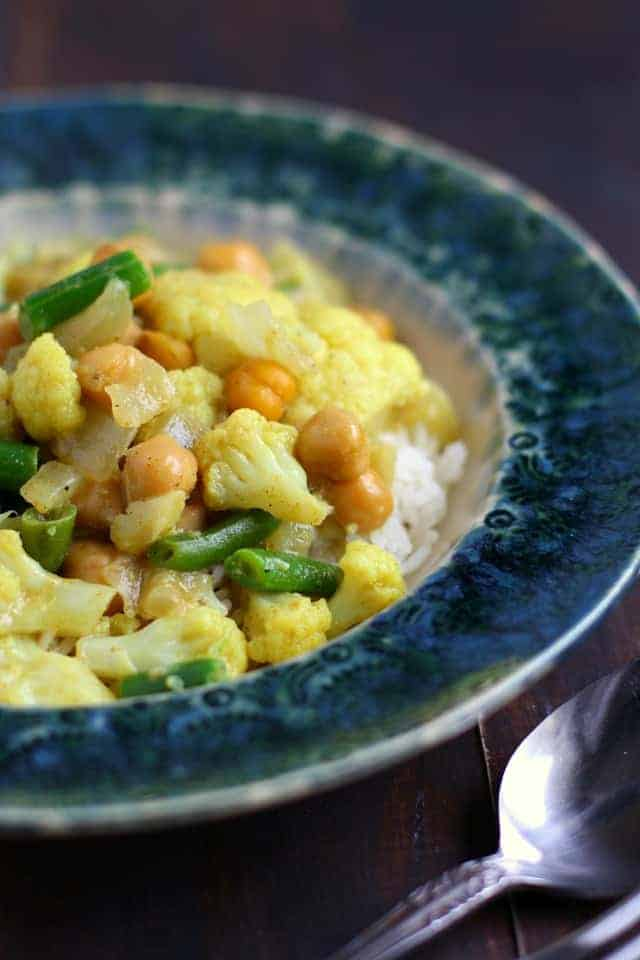 Cozy and comforting green bean and cauliflower curry is an easy meal option that's vegan and allergy friendly!