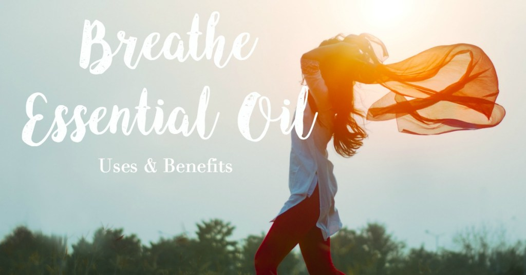 """A woman standing sideways in front of the sun with her arms bent above her head and her scarf flowing behind her with """"Breathe Essential Oil"""" written on the image."""