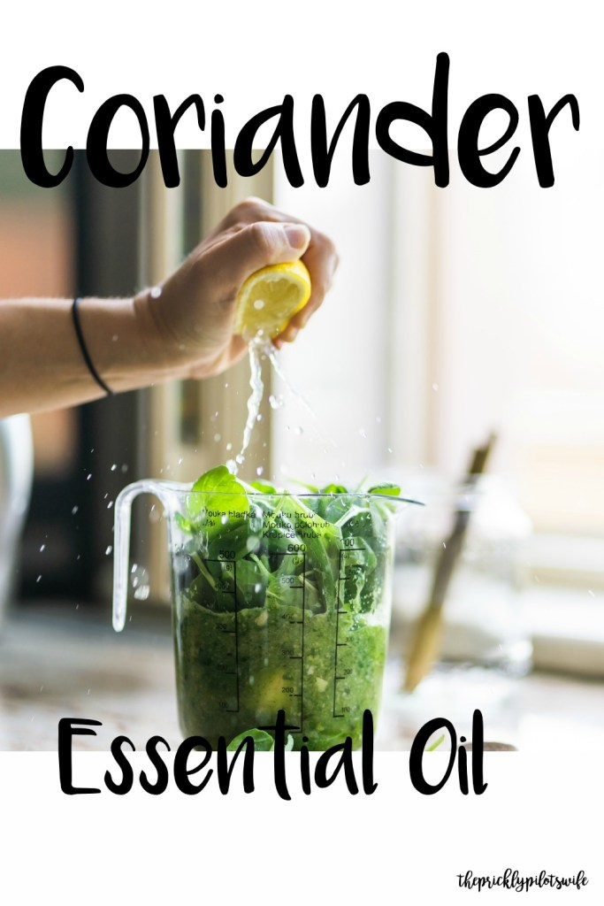 """Vertical image of various herbs and vegetables with a person squeezing a lemon over and has """"Coriander Essential Oil"""" written over the image. // The Prickly Pilot's Wife"""