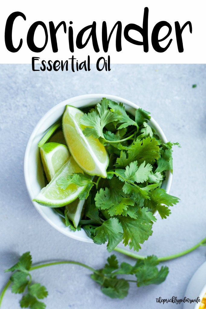 """Vertical image of sliced limes and cilantro stems in a white clay bowl with """"Coriander Essential Oil"""" written over the image. // The Prickly Pilot's Wife"""