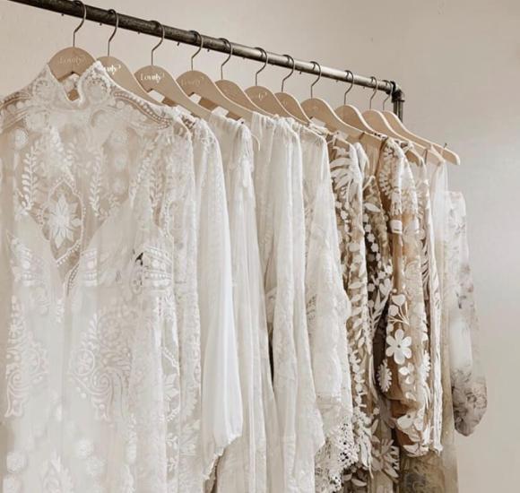 Row of boho wedding dresses on a dress rack