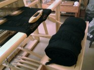 The first warp is done. That's it rolled up on the bench.