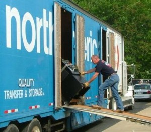 Slot machine raid; St. Mary's Deputy Julian Schwab loading seized slots on van at ADF