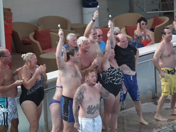 """""""de Plane, de Plane"""" hollers Tattoo. Pool fun on the Celebrity Eclipse from folks who may not care about the bottled water not being provided as part of the upgraded Aqua class suites. One has to wonder about what kind of numbskull working as a Celebrity executive dreamed up this idea to reduce overhead via the elimination of two bottles of water per day for passengers already paying a cabin upgrade. Maybe that bozo formerly worked for Carnival and was in charge of keeping engines from catching fire. THE PRIVATEER CLAUSE photo"""