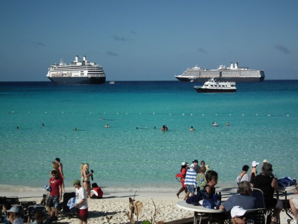 This view from the Carnival-owned private island in the Bahamas is exactly why MSC has gotten into the island business for its customers. In the distance, moored offshore, are the Holland America Eurodam and Amsterdam. THE PRIVATEER CLAUSE photo.