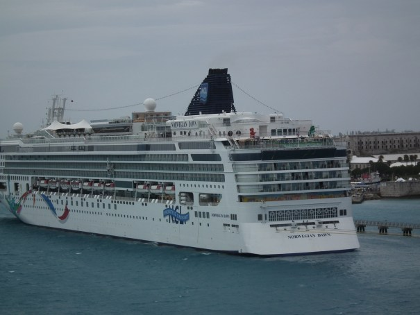 The Norwegian Star in port at the Royal Dockyard in Bermuda as the Grandeur slides into the terminal in front of her. THE PRIVATEER CLAUSE photo