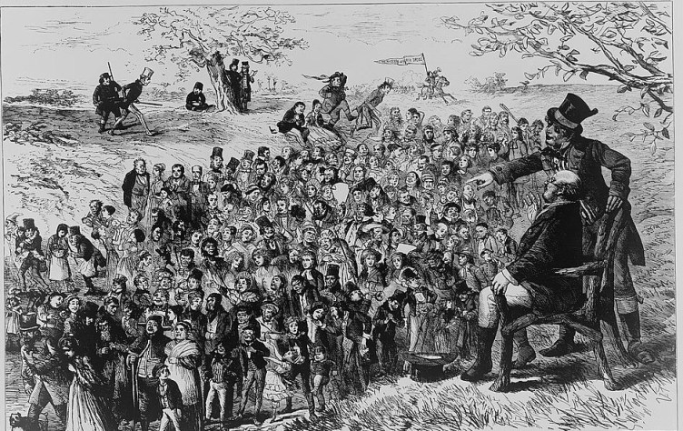 An elderly man, possibly Charles Dickens, seated in a chair as a mob of fictional characters from books by Dickens passes before him.