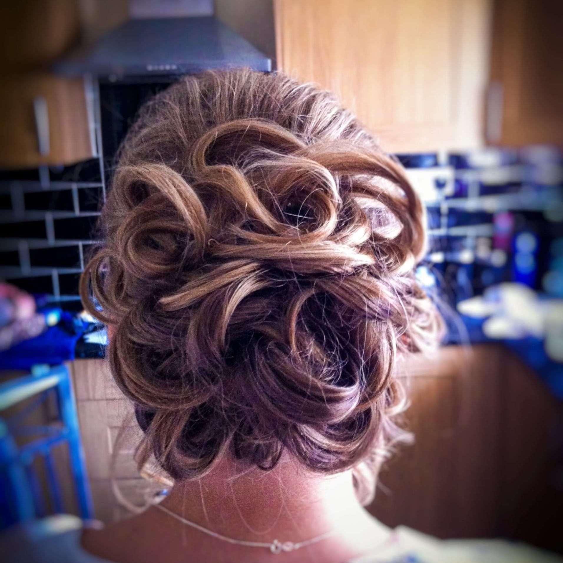 My Wedding Hair. A loose bun made of curls