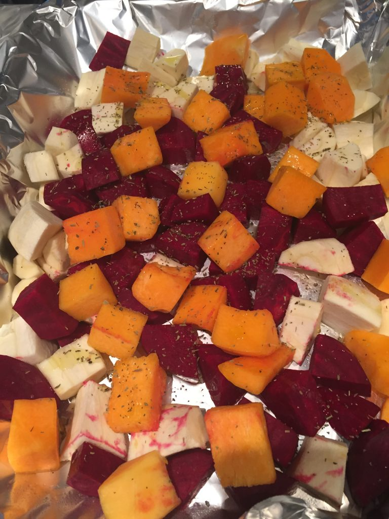Sprinkle olive oil, salt and herbs de Provence on the cubed veggies to make The Best Roasted Root Vegetables Ever from The Professional Mom Project