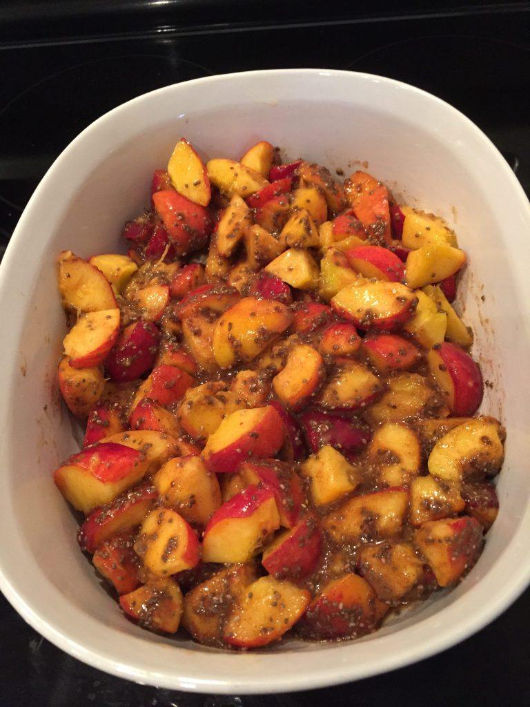 Mixture of peaches, chia seeds and cornstarch to make Vegan Gluten Free Peach Crumble from The Professional Mom Project