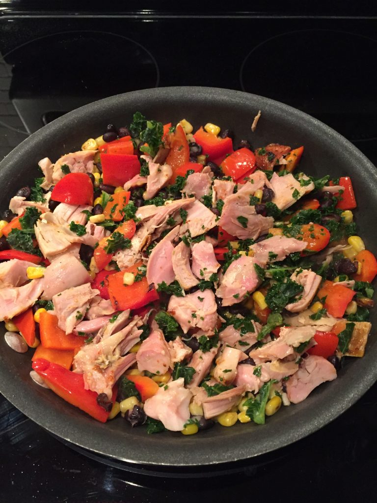 Add the chicken and kale to the rest of the veggies for the BBQ burrito bowl