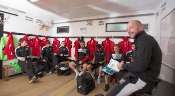 Sheffield FC players having a pre-match team talk