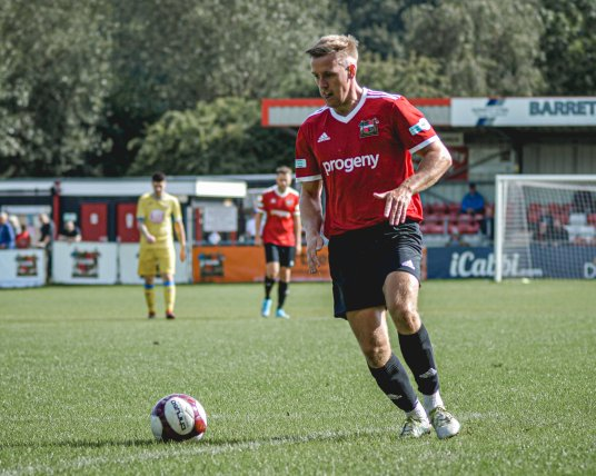 Male Sheffield FC player preparing to kick ball