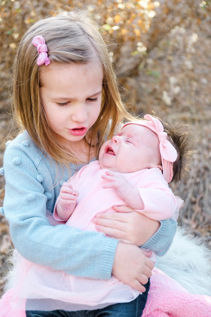 big sister comforting little sister