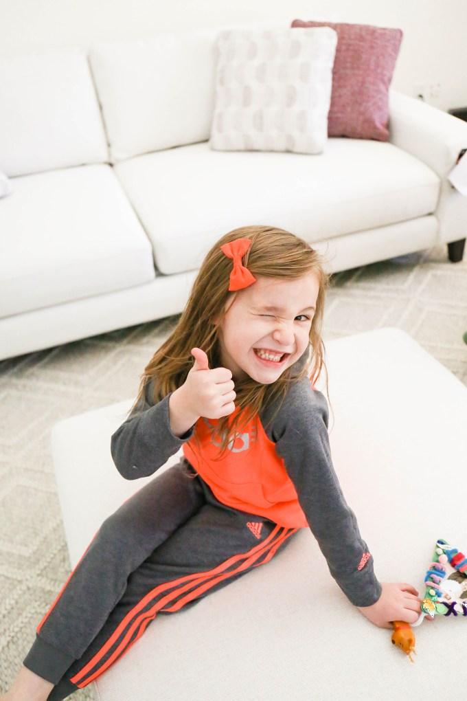 little girl giving thumbs up