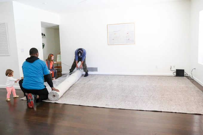 furniture delivery rolling out rug